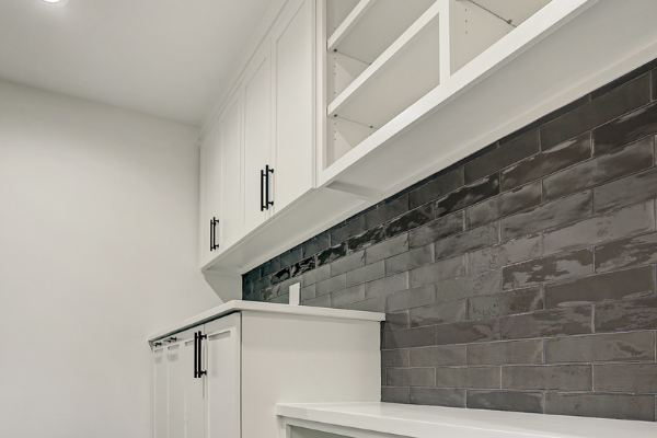 Custom Laundry Room Remodeling With Black Back Splash Houston