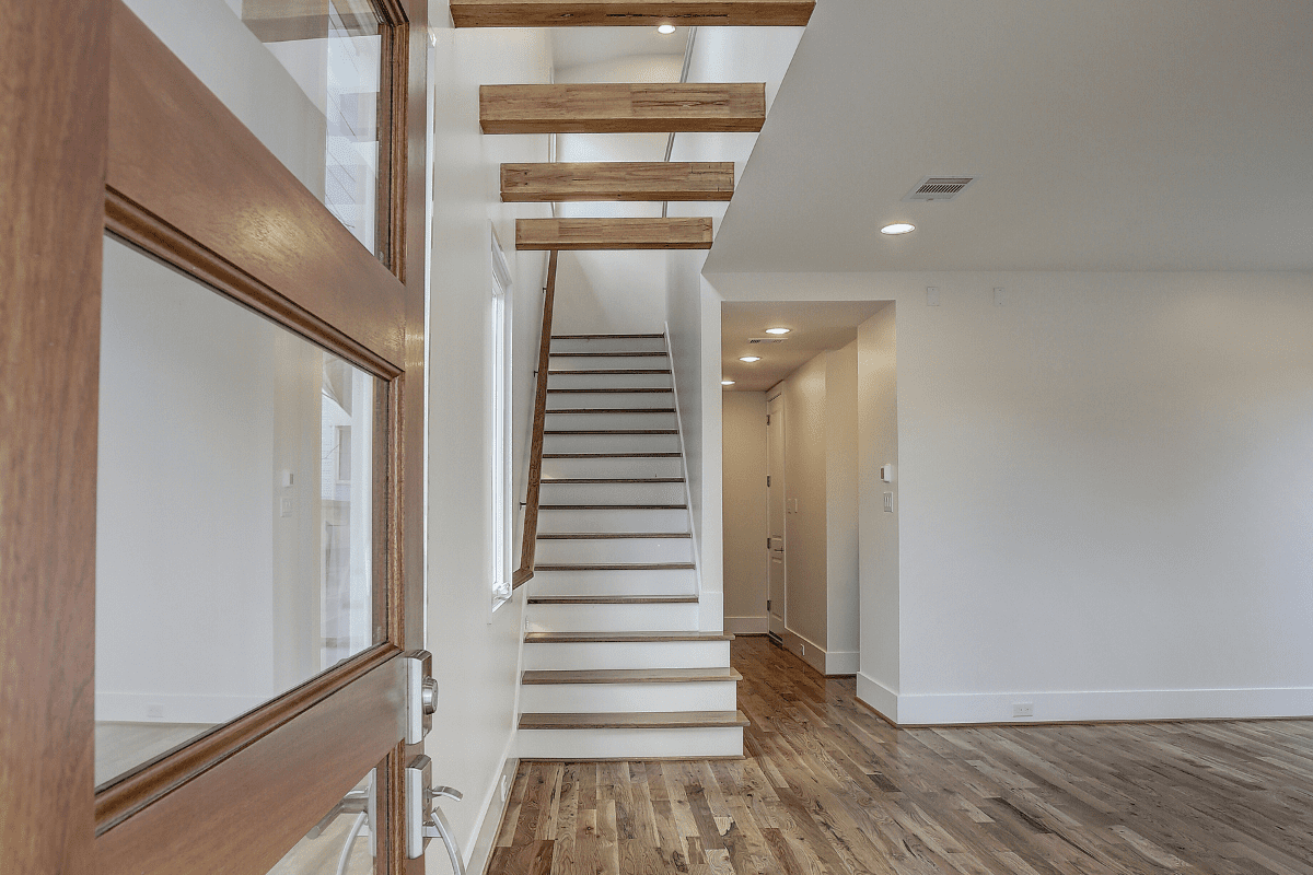 Luxury Home Build Entry Way with Exposed Beams