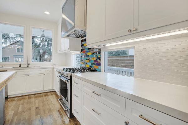 Low Windows with Custom Backsplash in a Luxury Kitchen