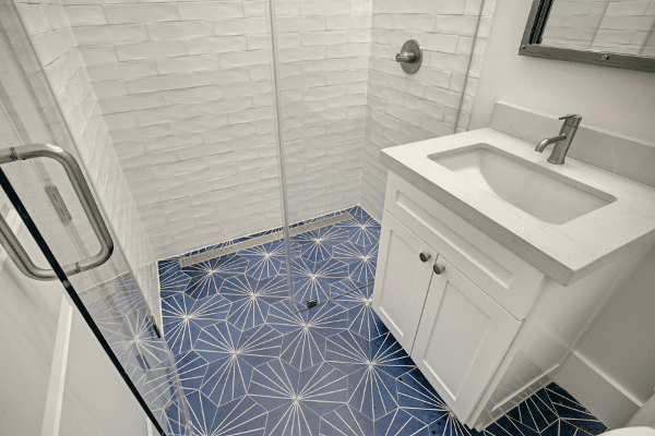 Luxury Home Bathroom with blue Tile and Single Sink