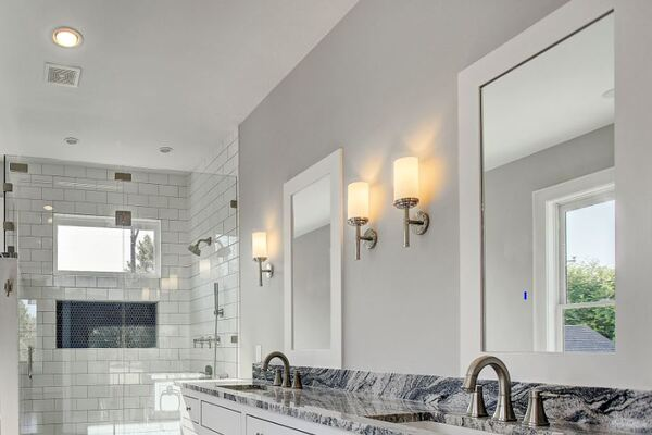 Custom Home Bathroom Remodel with a Double Vanity and Industrial Light Fixtures