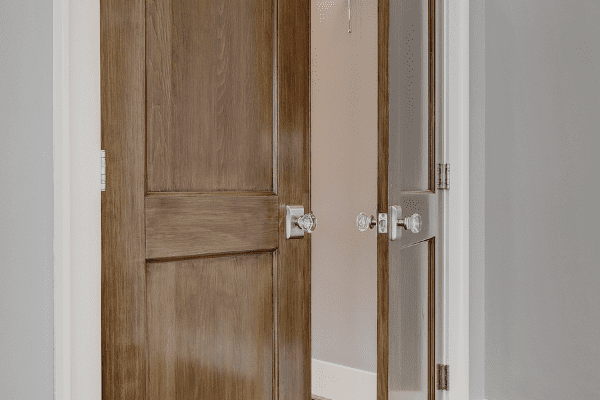 Vintage Door Knobs on Industrial Style Doors in a Houston Heights Remodel