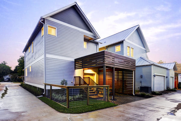 Backyard of A Light Blue Two-Story Custom Farmhouse in Houston Texas