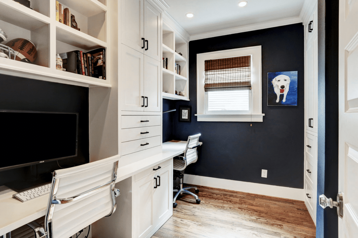 A Custom Built Desk with White Cabinets and Blue Walls