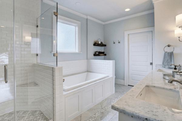 Custom Home Bathroom in Houston Texas with a Double Vanity and Custom Storage Space Under The Bathtub