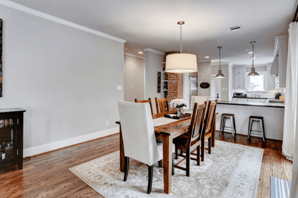 Custom Home Dining Room with a Wooden Chairs and Redwood Floor in Houston Heights