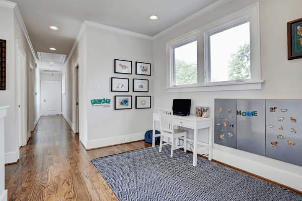 Custom Home Hallway With a White Desk and Chair in Houston Heights