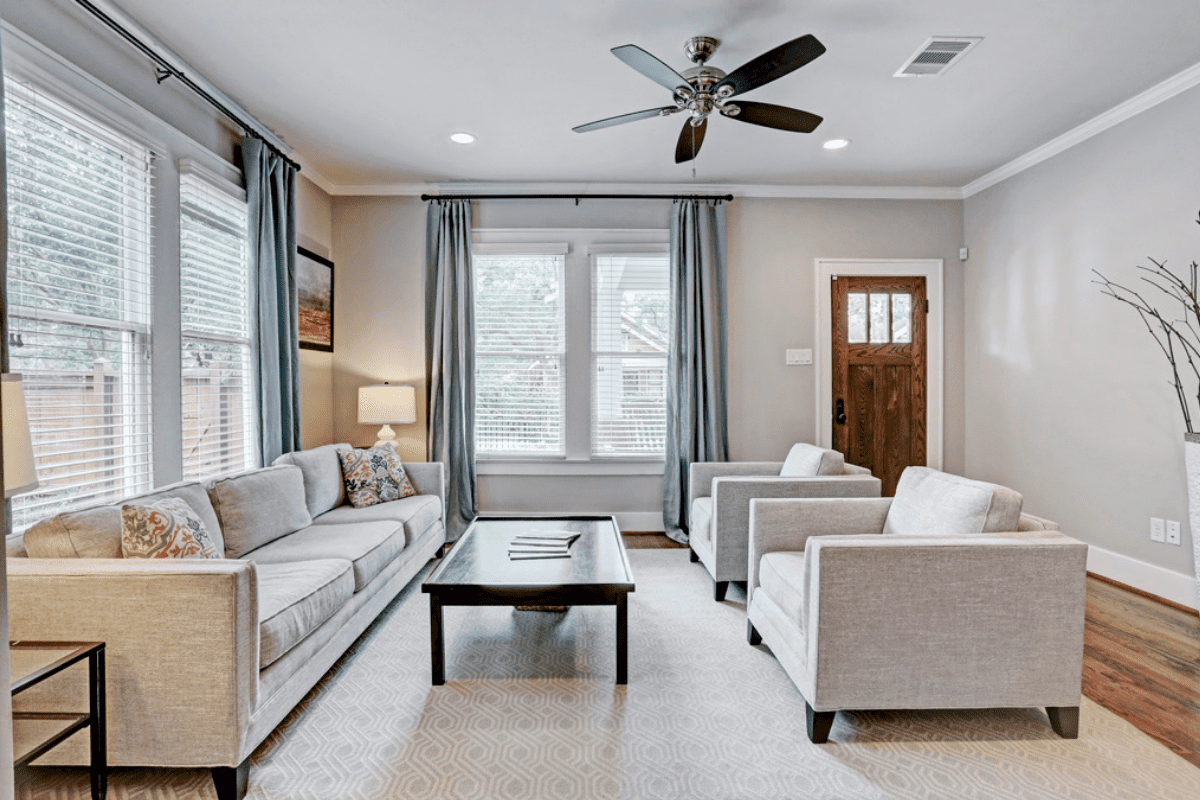 Custom Home Living Room With Two Custom Burrow Chairs and a Three Cushion Couch in Houston, Texas