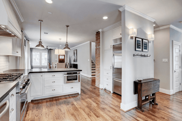 Custom Home in Houston with Wooden Floors and White Cabinets in the Luxury Kitchen in Houston Heights