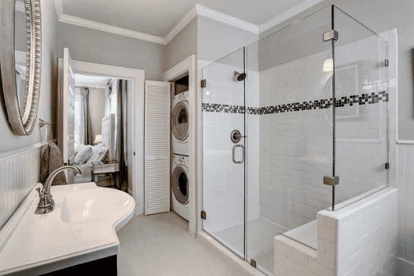 Custom Luxury Home Bathroom in Houston with a Glass Walk-in Shower and a Single Sink