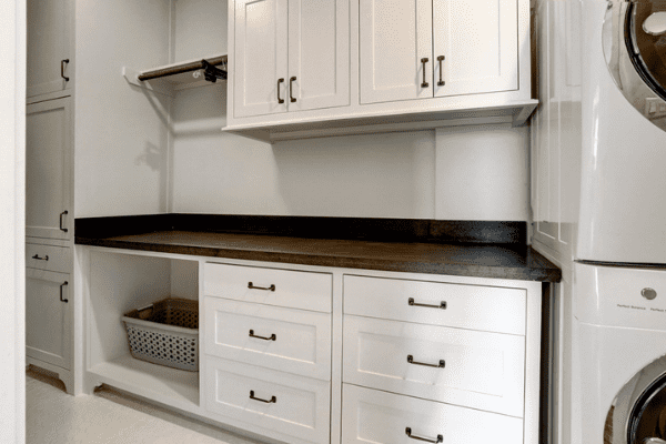 Custom Storage Space Next to a Washer and Dryer for Quick Access