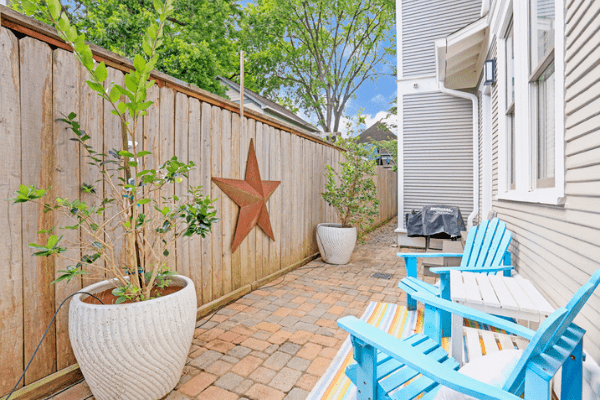 Houston Heights Backyard with the Texas Star on the Fence and Two Blue Patio Chairs