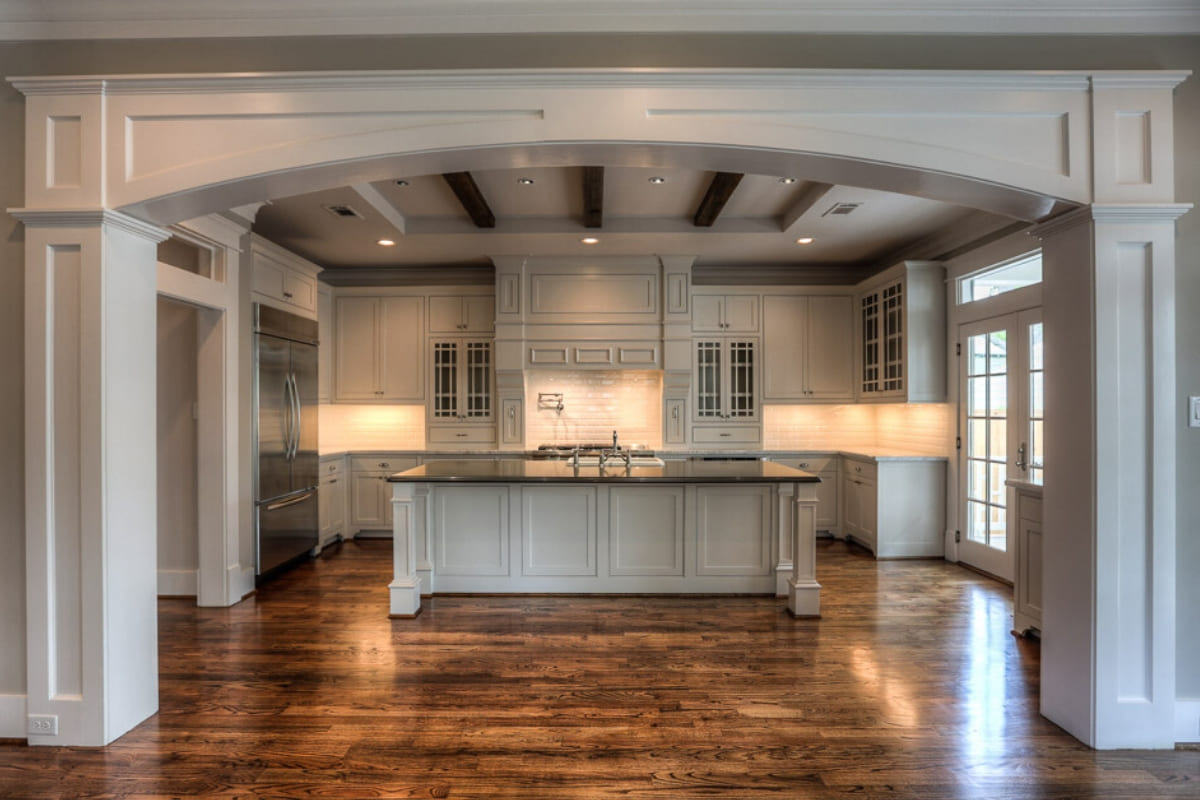 Custom luxury kitchen in Houston with exposed wooden ceiing beams