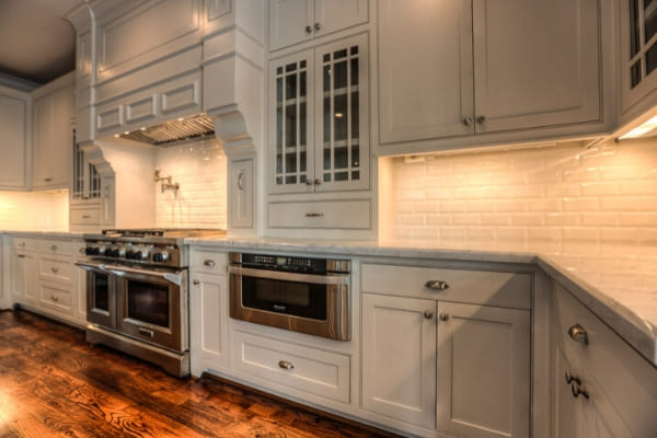 New kitchen appliances and white subway tile back splash in custom Houston kitchen