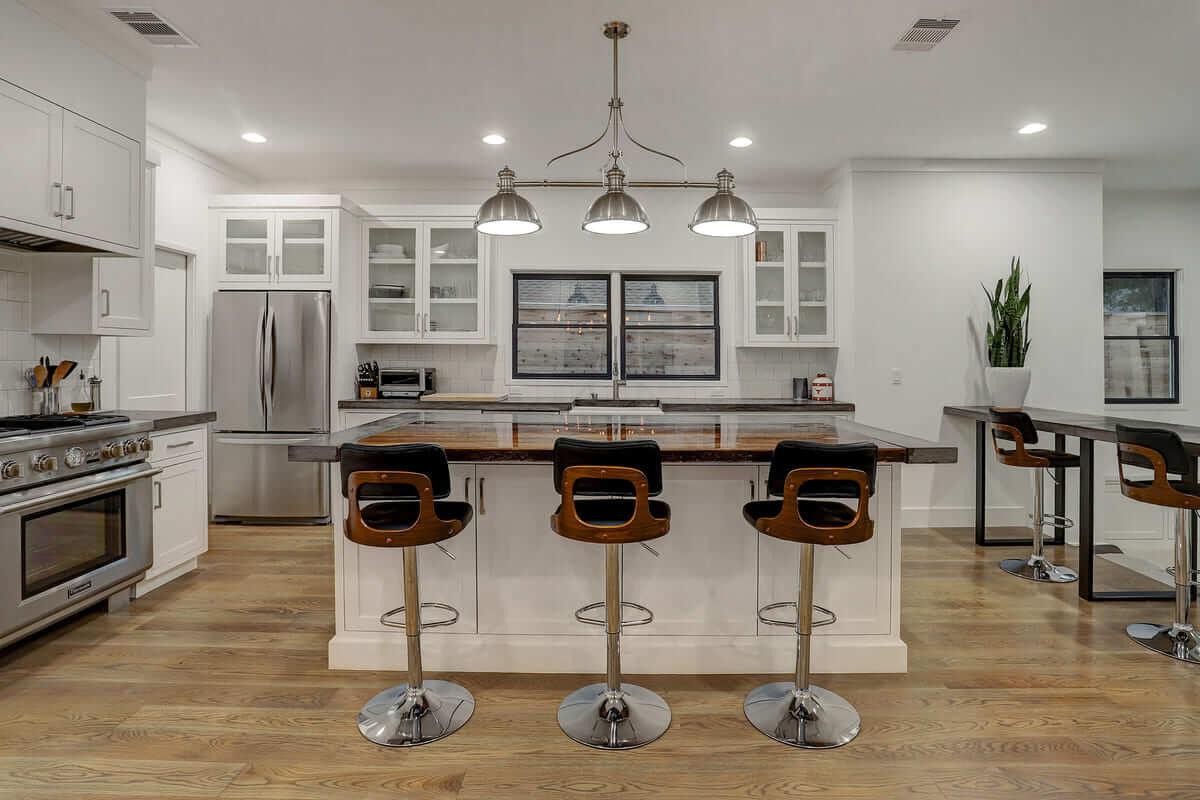 Ashland 1418 Houston Additon & Remodel White Modern Kitchen with Custom Concrete Island
