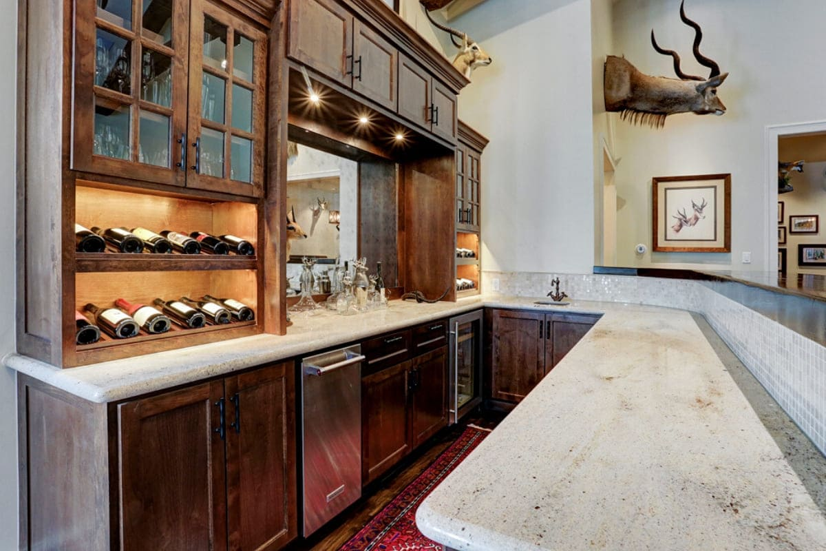Custom wood bar with stainless steel appliances and bar sink in Houston, Texas
