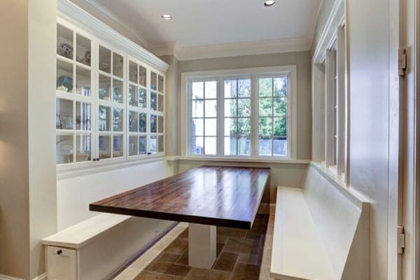 Built-in table in front of glass front storage
