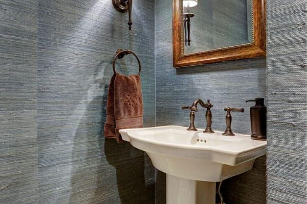 Custom pedestal sink in Houston bathroom remodel by Southern Green Builders