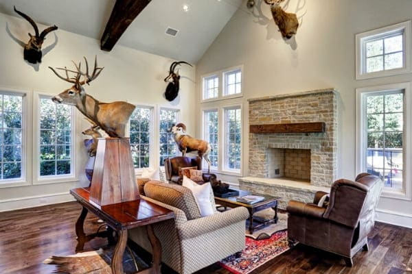 Custom fireplace in Houston, Texas surrounded by animal trophies