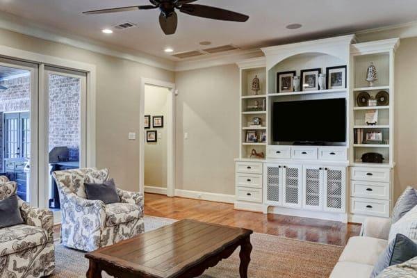 Custom white entertainment center in remodeled living room in Houston, Texas